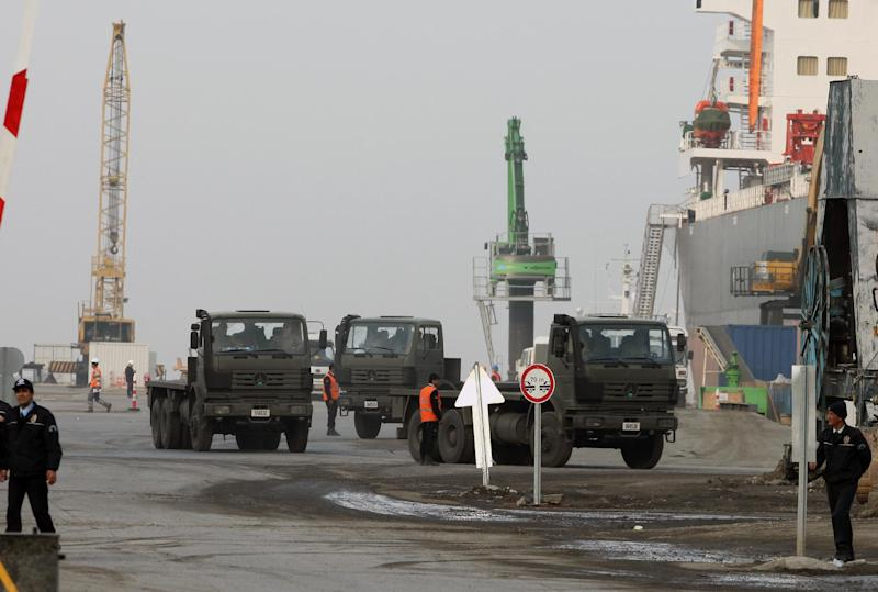 Turkish riot police stationed at the entrance of the port, prior to the Dutch military truck carrying NATO's Patriot Missile Defense System to protect Turkey, in case neighboring Syria launches an attack, leaving the Mediterranean city of Iskenderun, Turkey, Wednesday, Jan. 23, 2013. The Dutch Patriot Systems and troops are heading for Adana to prepare to operate a defensive missile system close to the border with Syria. (AP Photo/Burhan Ozbilici)