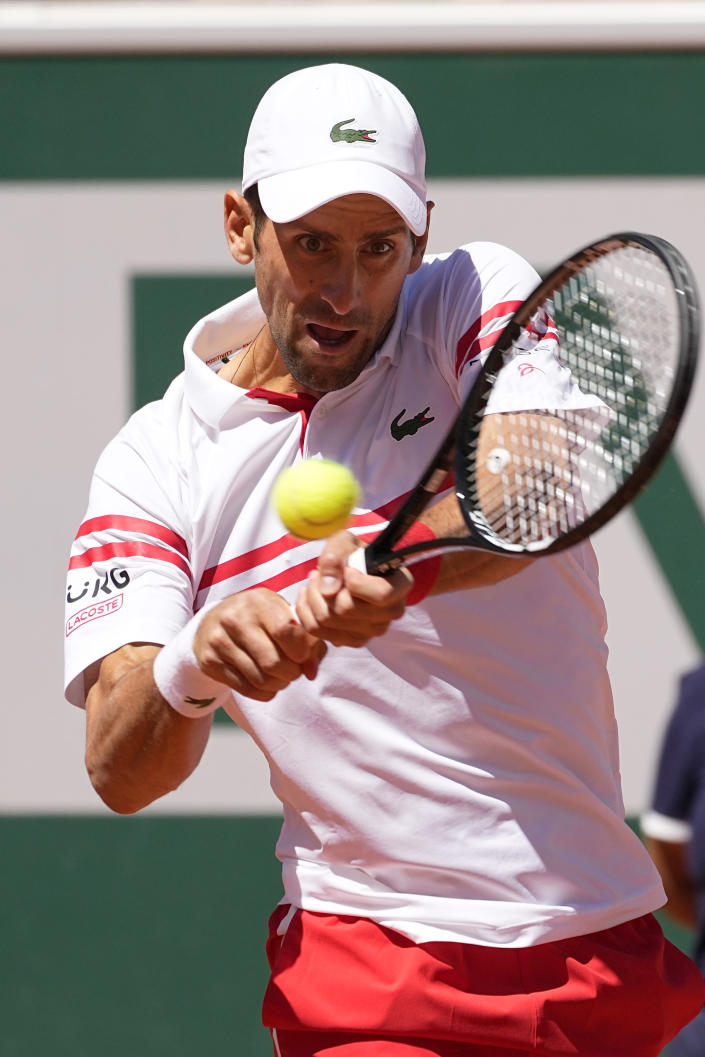 Serbia's Novak Djokovic backhands to Stefanos Tsitsipas of Greece during their final match of the French Open tennis tournament at the Roland Garros stadium Sunday, June 13, 2021 in Paris. (AP Photo/Michel Euler)