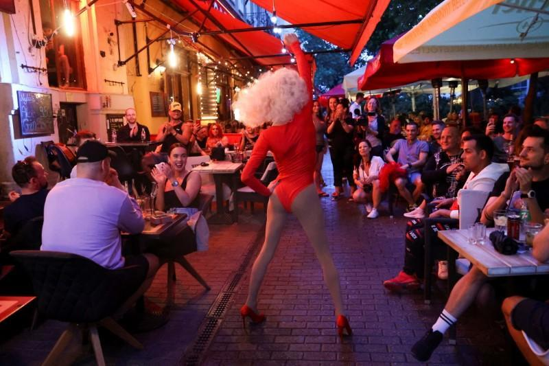 Draq queen Katherine Taylor performs during a drag queen show in a bar in Budapest