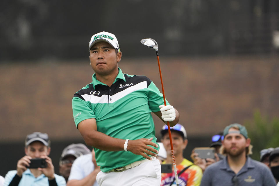 FILE - In this June 18, 2021, file photo, Hideki Matsuyama, of Japan, watches his shot during the second round of the U.S. Open Golf Championship at Torrey Pines Golf Course in San Diego. Matsuyama spent 10 days recovering from the coronavirus leading up to the Olympics in his native Japan. (AP Photo/Jae C. Hong, File)