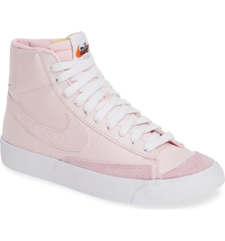 "<p><a href=""https://www.popsugar.com/buy/Nike-Blazer-Mid-Sneakers-489872?p_name=Nike%20Blazer%20Mid%20Sneakers&retailer=shop.nordstrom.com&pid=489872&price=100&evar1=moms%3Aus&evar9=46619473&evar98=https%3A%2F%2Fwww.popsugar.com%2Fphoto-gallery%2F46619473%2Fimage%2F46619488%2FNike-Blazer-Mid-Sneakers&list1=sneakers%2Cmom%20shopping&prop13=api&pdata=1"" rel=""nofollow"" data-shoppable-link=""1"" target=""_blank"" rel=""nofollow"" class=""ga-track"" data-ga-category=""Related"" data-ga-label=""https://shop.nordstrom.com/s/nike-blazer-mid-77-vintage-sneaker-unisex/5284472?origin=keywordsearch-personalizedsort&amp;breadcrumb=Home%2FAll%20Results&amp;color=pink%20foam%20%2F%20pink%20foam%2F%20white"" data-ga-action=""In-Line Links"">Nike Blazer Mid Sneakers</a> ($100) go with everything from jeans to sweats to skirts and tights.</p>"