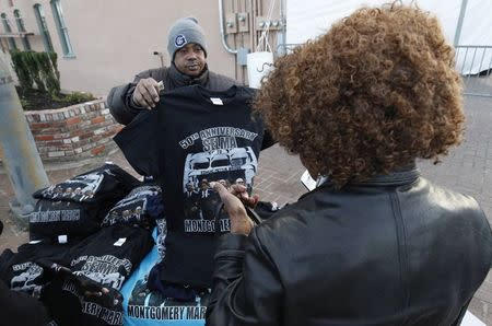 Thaddeus Jackson (L), shows off a t-shirt commemorating the 50th anniversary march in Selma, Alabama March 6, 2015. REUTERS/Tami Chappell