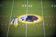 FILE - In this Aug. 28, 2009 file photo, the Washington Redskins logo is shown on the field before the start of a preseason NFL football game against the New England Patriots in Landover, Md. The Washington Redskins are undergoing what the team calls a thorough review of the nickname. In a statement released Friday, July 3, 2020, the team says it has been talking to the NFL for weeks about the subject. Owner Dan Snyder says the process will include input from alumni, sponsors, the league, community and members of the organization. FedEx on Thursday called for the team to change its name, and Nike appeared to remove all Redskins gear from its online store. (AP Photo/Nick Wass, File)