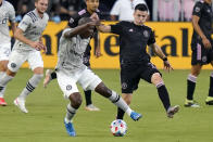 Montreal defender Kamal Miller, left, and Inter Miami midfielder Lewis Morgan go for the ball during the first half of an MLS soccer match Wednesday, May 12, 2021, in Fort Lauderdale, Fla. (AP Photo/Lynne Sladky)