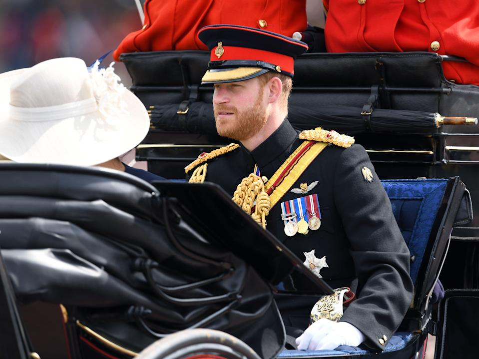 The Duke and Duchess of Sussex attending Trooping The Colour, Buckingham Palace, London. Picture credit should read: Doug Peters/EMPICS