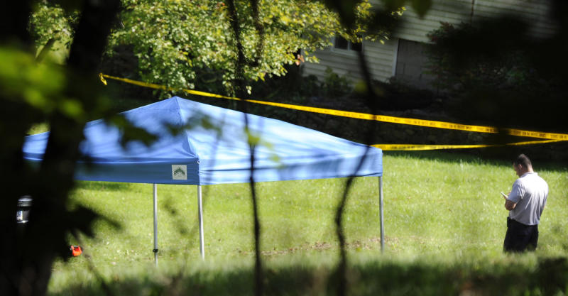 A blue tent protects the scene of a fatal shooting in New Fairfield, Conn., Thursday, Sept, 27, 2012. Police say Jeffrey Giuliano shot a masked teenager in self-defense during what appeared to be an attempted burglary early Thursday morning, then discovered that he had killed his son, Tyler. (AP Photo/The News-Times, Carol Kaliff)