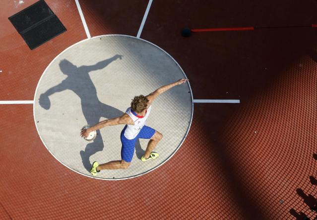 France's Kevin Mayer competes in the men's decathlon discus throw event at the London 2012 Olympic Games at the Olympic Stadium August 9, 2012. REUTERS/Pawel Kopczynski (BRITAIN - Tags: OLYMPICS SPORT ATHLETICS TPX IMAGES OF THE DAY)