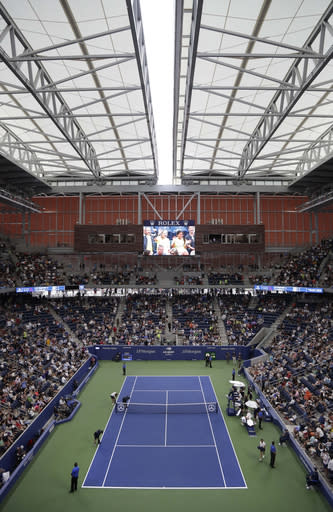 The roof loses on Louis Armstrong Stadium during a match between Kevin Anderson, of South Africa, and Denis Shapovalov, of Canada, in the third round of the U.S. Open tennis tournament, Friday, Aug. 31, 2018, in New York. (AP Photo/Julio Cortez)