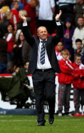 Sheffield Wednesday's manager Gary Megson applauds the away fans at the end of the match
