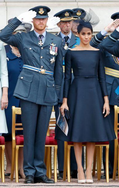 PHOTO: Prince Harry, Duke of Sussex and Meghan Markle, Duchess of Sussex attend a ceremony to mark the centenary of the Royal Air Force on the forecourt of Buckingham Palace, July 10, 2018 in London. (Max Mumby/Indigo/Getty Images)