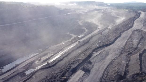 Dust from nine open pit coal mines often coats people and objects in Kiselyovsk, Russia. (Dmitry Kozlov/CBC - image credit)