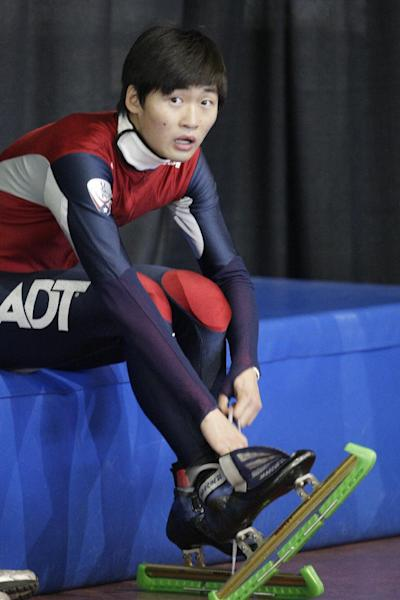 FILE - In this Sept. 30, 2012, file photo, the United States Simon Cho takes adjusting his skates after racing in a 500 meter semifinal at the U.S. Single Distance Short Track Speedskating Championship in Kearns, Utah. Cho said Friday, Oct. 5, 2012, he agreed to a coach's demand to tamper with a Canadian rival's skates last year after the command was made a third time and in Korean by Jae Su Chun. Chun has denied any wrongdoing but is suspended. (AP Photo/Rick Bowmer, File)