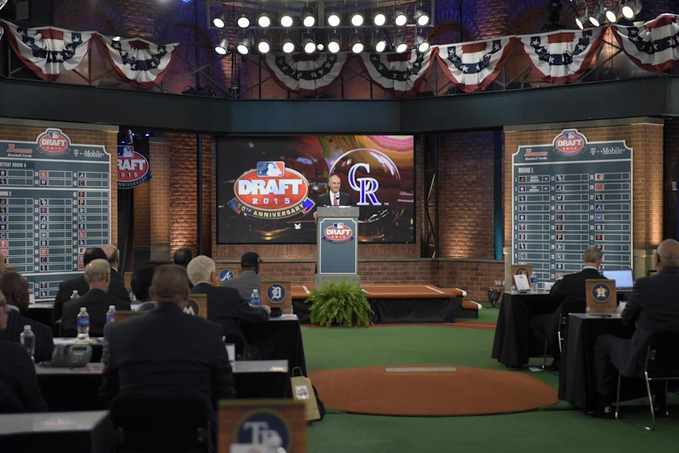 Commissioner of Major League Baseball Rob Manfred announces the third selection at the 2015 MLB baseball draft Monday, June 8, 2015, in Secaucus, N.J. Brendan Rodgers was chosen by the Colorado Rockies with the third selection. (AP Photo/Bill Kostroun)