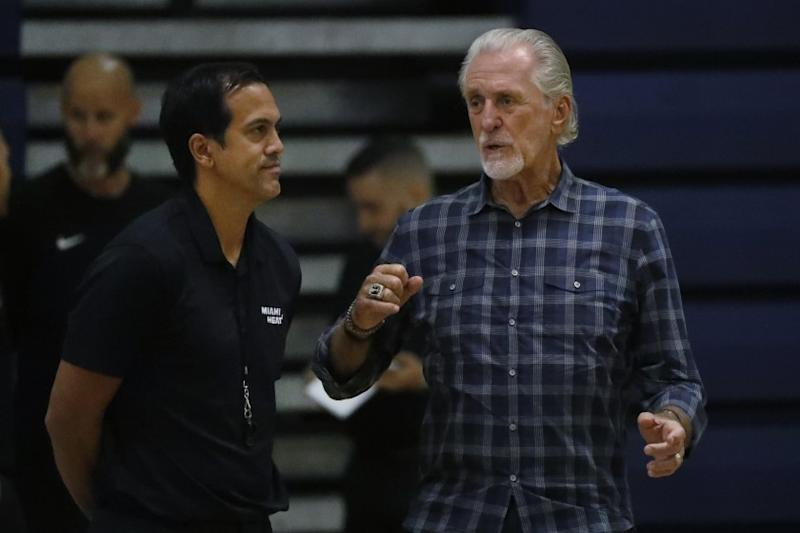 Miami Heat head coach Erik Spoelstra, left, talks with president Pat Riley during the team's NBA basketball practice at Keiser University, Tuesday, Oct. 1, 2019, in West Palm Beach, Fla. (AP Photo/Wilfredo Lee)