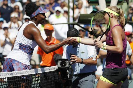 Mar 25, 2018; Key Biscayne, FL, USA; Venus Williams of the United States (L) shakes hands with Kiki Bertens of the Netherlands (R) after their match on day six of the Miami Open at Tennis Center at Crandon Park. Williams won 5-7, 6-3, 7-5. Geoff Burke-USA TODAY Sports