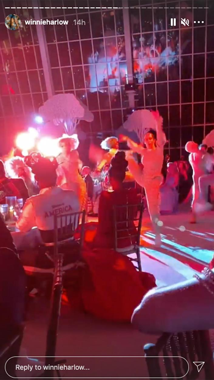 <p>Winnie Harlow was sure to snap a shot of the night's entertainment. </p>
