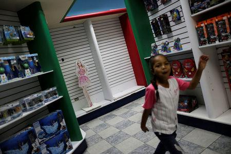 A child walks in a toy store in Caracas, Venezuela. REUTERS/Ueslei Marcelino