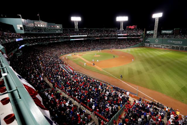 """Fans at Fenway Park hung a """"Trump 2020"""" campaign flag from the upper deck on Friday night, though other fans quickly ripped it down. (Getty Images)"""