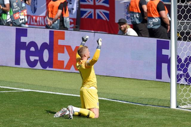 GUIMARAES, PORTUGAL - JUNE 09: Jordan Pickford of England celebrates after saving the decisive penalty from Josip Drmic of Switzerland during the UEFA Nations League Third Place Playoff match between Switzerland and England at Estadio D. Afonso Henriques on June 09, 2019 in Guimaraes, Portugal. (Photo by Octavio Passos - UEFA/UEFA via Getty Images)