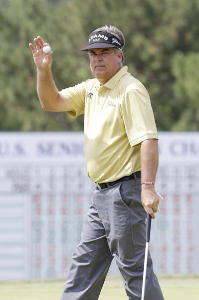 Kenny Perry acknowledges the crowd after finishing the 18th hole Saturday, July 13, 2013, in the third round of the U.S. Senior Open golf tournament in Omaha, Neb. (AP Photo/Nati Harnik)