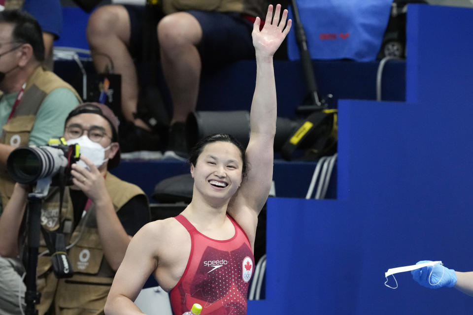 Margaret MacNeil, of Canada, reacts after winning the final of the women's 100-meter butterfly at the 2020 Summer Olympics, Monday, July 26, 2021, in Tokyo, Japan. (AP Photo/Petr David Josek)