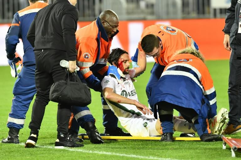 Saint-Etienne's Serbian was stretchered off after at Bordeaux after colliding with his own goalkeeper Stephane Ruffier