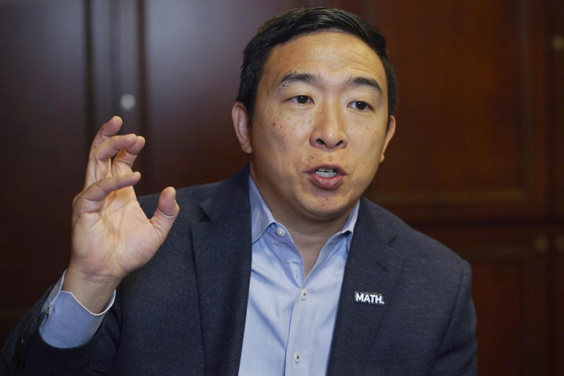 In this Dec. 5, 2019, photo, Democratic presidential candidate businessman Andrew Yang speaks during an interview with The Associated Press in Chicago. Of all the Democrats in the wide field running for president, Yang is having the most fun. Unburdened by expectations and untethered to political convention, the tech entrepreneur has spent months cruising around the country, delivering dark warnings about America's new tech economy with an odd mix of millennial humor and bite. (AP Photo/Teresa Crawford)