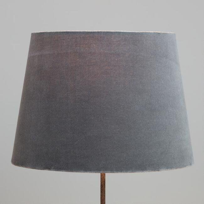 "<a href=""https://www.worldmarket.com/product/gray-velvet-table-lamp-shade.do"" target=""_blank"">Shop it here</a>."