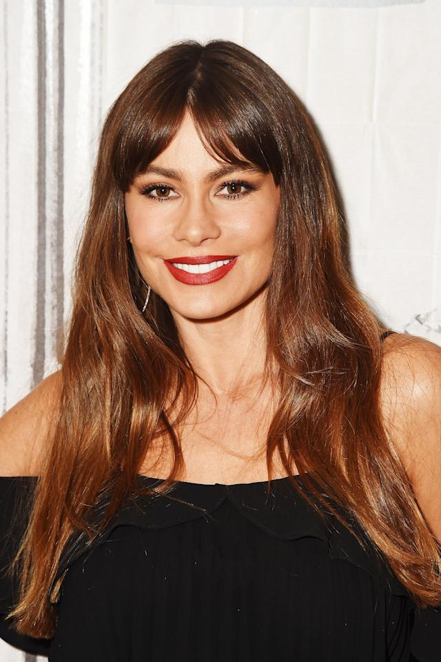 <p>Sofia Vergara stopped by the BUILD Series to discuss her EBY lingerie line while sporting enviable caramel highlights, winged eyeliner, and crimson-red lipstick. (Photo: Nicholas Hunt/Getty Images) </p>