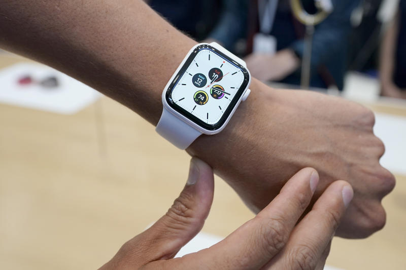 An apple employee wears the new iWatch series 5 during an event to announce new products Tuesday, Sept. 10, 2019, in Cupertino, Calif. (AP Photo/Tony Avelar)