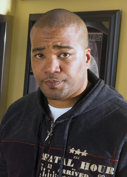 FILE - This Feb. 28, 2007 file photo shows hip-hop mogul Chris Lighty in his office in New York. Lightly died of an apparent gunshot wound on Thursday, Aug. 30, 2012 at his home in the Bronx borough of New York. He was 44. Lighty was the man behind rap's leading figures, helping them not only attain hit records, but lucrative careers outside of music. He had been a part of the rap scene for decades, working with pioneers like LL Cool J, KRS-One before starting his own management company, Violator.(AP Photo/Jim Cooper, file)