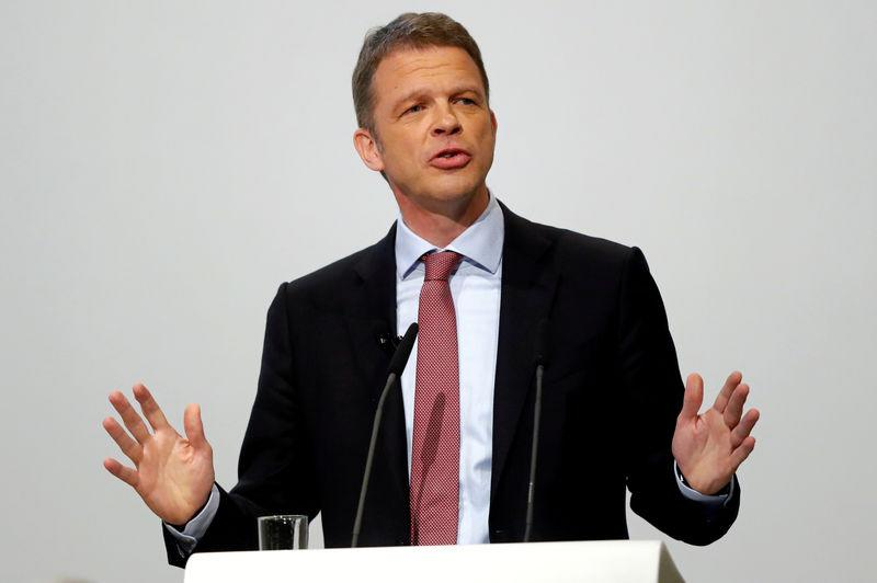 FILE PHOTO: Christian Sewing, new CEO of Germany's Deutsche Bank, gestures as he addresses the audience during the bank's annual meeting in Frankfurt, Germany, May 24, 2018. REUTERS/Kai Pfaffenbach/File Photo