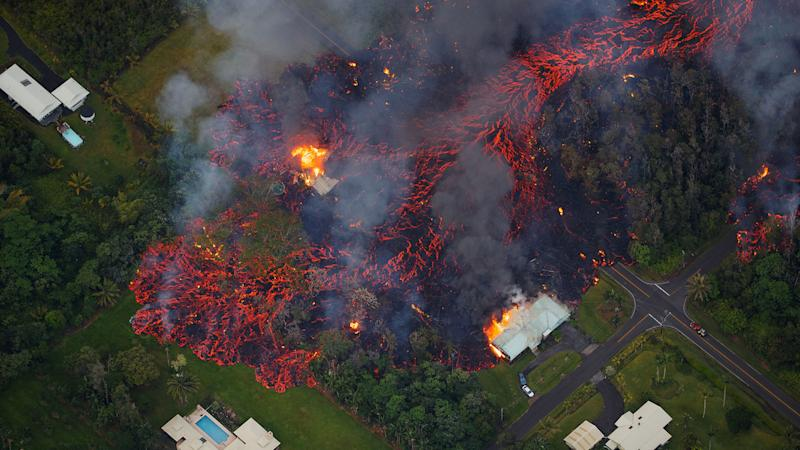 Mandatory Credit: Photo by BRUCE OMORI/PARADISE HELICOPTERS/EPA-EFE/REX/Shutterstock (9664416k)Activity continues on Kilauea's east rift zone, as a robust fissure eruption in Leilani Estates sends a massive flow into the subdivision, consuming all in its path, near Pahoa, Hawaii, USA, 06 May 2018.