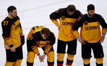 Ice Hockey - Pyeongchang 2018 Winter Olympics - Men's Final Game - Olympic Athletes from Russia v Germany - Gangneung Hockey Centre, Gangneung, South Korea - February 25, 2018 - Patrick Reimer, Bjorn Krupp, Jonas Muller and Yasin Ehliz of Germany react after their overtime loss. REUTERS/Brian Snyder