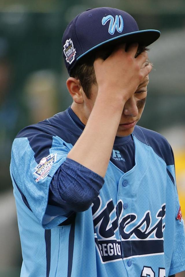 Las Vegas' pitcher Brennan Holligan collects himself on the mound in the second inning of the United States Championship game against Chicago at the Little League World Series tournament in South Williamsport, Pa., Saturday, Aug. 23, 2014. Chicago won 7-5. (AP Photo/Gene J. Puskar
