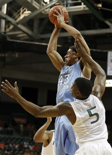 North Carolina's James Michael McAdoo (43) looks to pass as Miami's DeQuan Jones (5) defends during the first half of an NCAA college basketball game, Wednesday, Feb. 15, 2012, in Coral Gables, Fla. (AP Photo/Lynne Sladky)