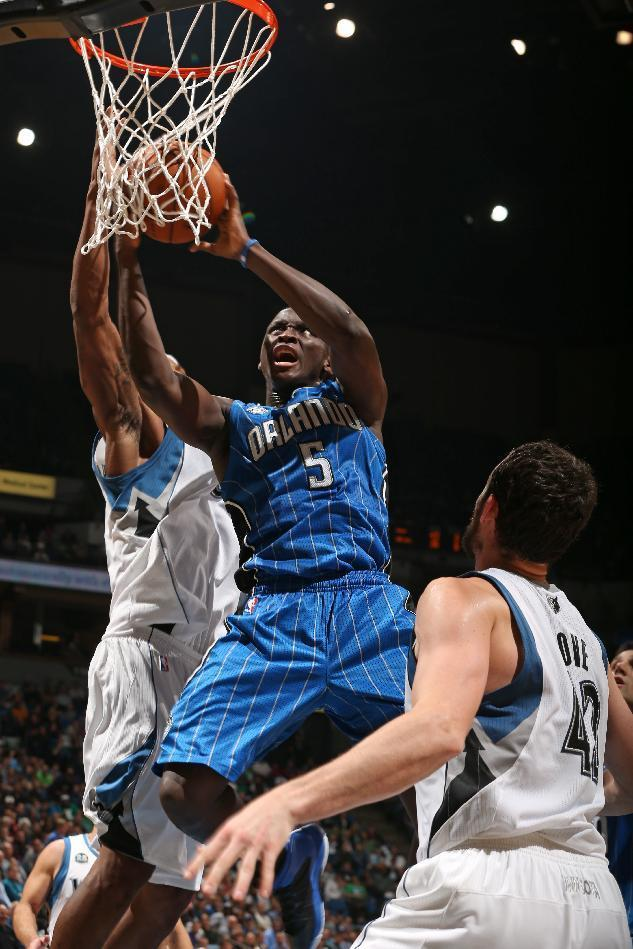 MINNEAPOLIS, MN - OCTOBER 30: Victor Oladipo #5 of the Orlando Magic drives to the basket against the Minnesota Timberwolves during the season and home opening game on October 30, 2013 at Target Center in Minneapolis, Minnesota. (Photo by David Sherman/NBAE via Getty Images)