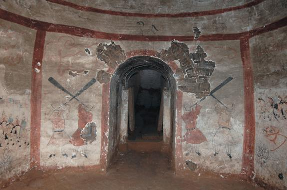 Four men blow into long horns at the entranceway into a 1,500-year-old tomb chamber, located on the south wall. The mural tomb likely held a military commander and his wife in what is now Shuozhou City, China.