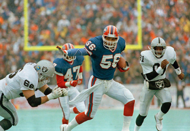 The Buffalo Bills' Darryl Talley heads for a touchdown after intercepting a Jay Schroeder pass. (AP)