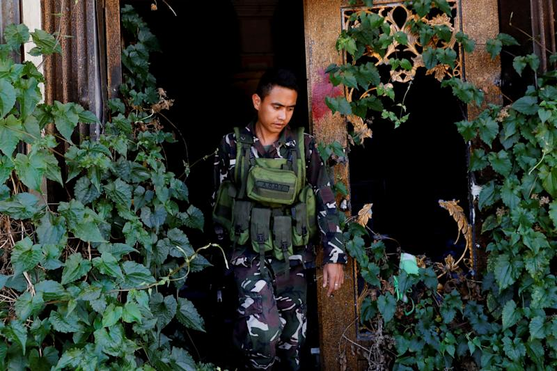 A soldier walks out of a destroyed structure at the most affected war-torn area of Marawi City, Lanao del Sur province, Philippines. (Photo: Eloisa Lopez/Reuters)