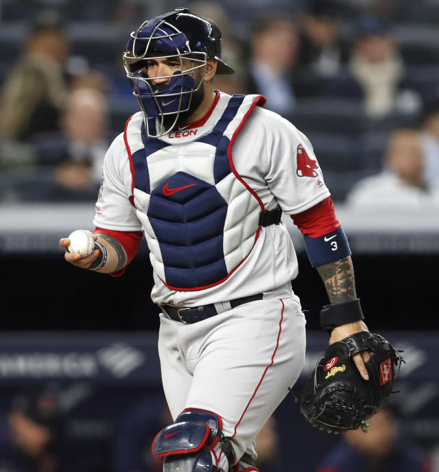 Boston Red Sox catcher Sandy Leon returns to his position after picking up a foul ball during the sixth inning of the team's baseball game against the New York Yankees, Tuesday, April 16, 2019, in New York. (AP Photo/Kathy Willens)