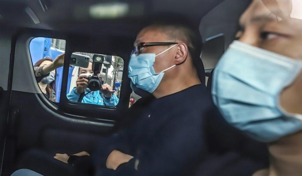 Police escort online radio host Wan Yiu-sing to North Point Police Station last year following his arrest on suspicion of money laundering and violating the national security law. Photo: Xiaomei Chen