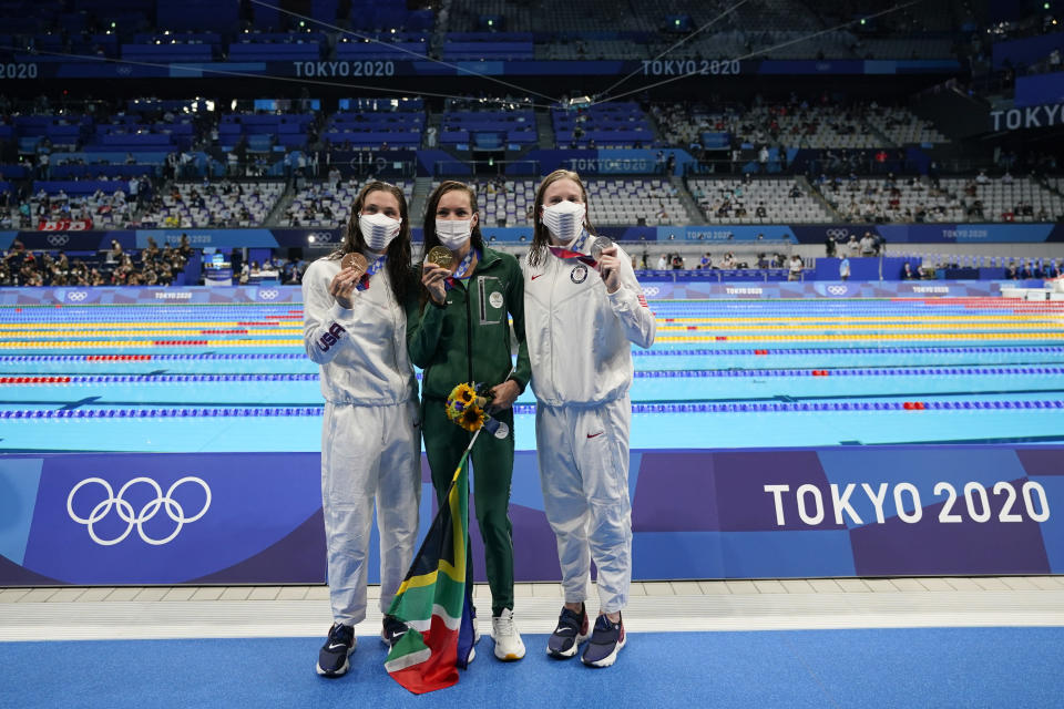 From left, Annie Lazor, of United States, Tatjana Schoenmaker, of South Africa, and Lilly King, of United States, pose with their medals after the women's 200-meter breaststroke final at the 2020 Summer Olympics, Friday, July 30, 2021, in Tokyo, Japan. (AP Photo/Jae C. Hong)
