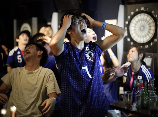 <p>Japanese fans react after second goal by Belgium as they watch a broadcast of the World Cup Round of 16 soccer match Belgium vs Japan at a sports bar in Tokyo, Japan July 3, 2018. REUTERS/Issei Kato </p>