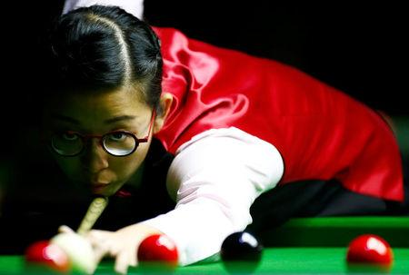 Ng On Yee of Hong Kong plays a shot during her semi-final match against Reanne Evans of England during the Eden World Women's Snooker Championship in Singapore