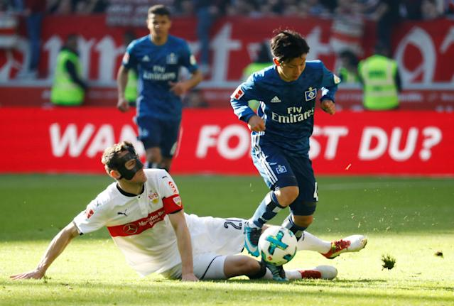 Soccer Football - Bundesliga - VfB Stuttgart vs Hamburger SV - Mercedes-Benz Arena, Stuttgart, Germany - March 31, 2018 Hamburg's Tatsuya Ito in action with Stuttgart's Christian Gentner REUTERS/Kai Pfaffenbach DFL RULES TO LIMIT THE ONLINE USAGE DURING MATCH TIME TO 15 PICTURES PER GAME. IMAGE SEQUENCES TO SIMULATE VIDEO IS NOT ALLOWED AT ANY TIME. FOR FURTHER QUERIES PLEASE CONTACT DFL DIRECTLY AT + 49 69 650050
