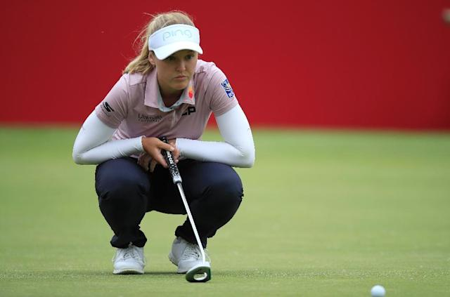 Canada's Brooke Henderson lines up a putt on the 18th hole during the second round of the Meijer Classic at Blythefield Country Club (AFP Photo/ANDY LYONS)