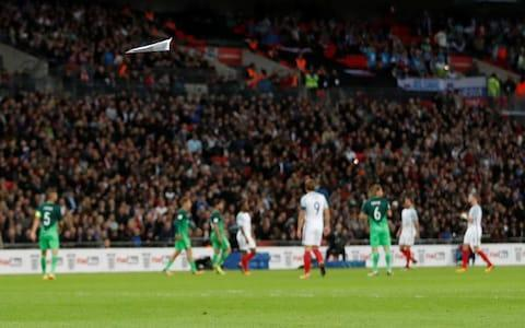 <span>England supporters resorted to throwing paper planes</span> <span>Credit: reuters </span>
