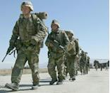 US soldiers arrive at Bagram Air Base, in Afghanistan in 2002: experts say the two-decade US war effort has 'failed' due to hubris and misundertanding