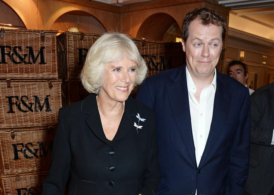 LONDON, ENGLAND - OCTOBER 21:  Camilla, Duchess of Cornwall, and son Tom Parker Bowles attend Fortnum & Mason's Diamond Jubilee Tea Salon for the launch of Tom Parker Bowles' new book